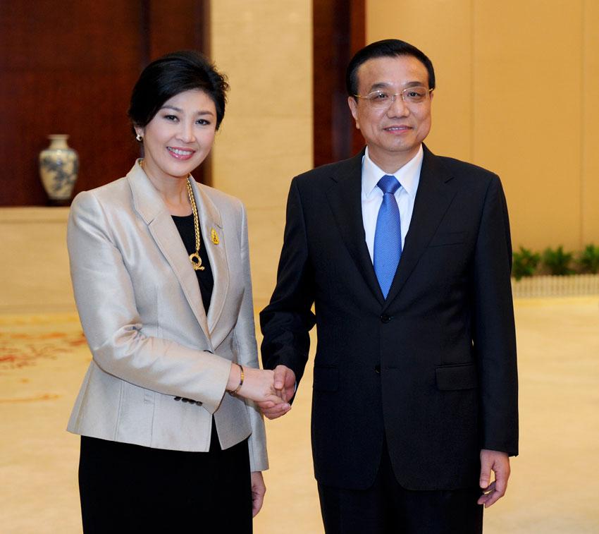 9月2日,国务院总理李克强在南宁会见前来出席第十届中国-东盟博览会暨中国-东盟商务与投资峰会的泰国总理英拉。新华社记者 张铎 摄