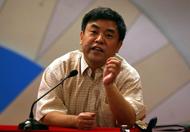 """中国社会科学院中国特色社会主义理论体系研究中心主任尹韵公认为,三中全会明确文化体制改革""""以人民为导向""""。进一步深化体制改革,一定要坚持以人民为中心的工作导向。"""