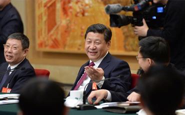 """梦想就像中国足球 想了才有可能  3月5日下午,习近平总书记来到上海代表团,与代表们一起审议政府工作报告。总书记谈到,中国五千年文明是世界文化的河流中唯一没有干涸断流的文明。我们建设中国特色社会主义文化,树立核心价值观,必须弘扬民族传统文化,去找我们的精气神。文化的软实力是国家强盛的外在标志。廖昌永讲到的梦想中国的歌剧能够到世界舞台上去,这些事情我们要作为一个追求目标去做。就跟我谈中国足球一样,看起来比较遥远,但是还得讲啊,你没有这个梦想,也不去想,就根本达不到,你想了才有这可能。要种苗圃而不是做盆景  自贸区开局良好、运行有序。习近平总书记提出要求,自贸区建设就是要建成制度创新的高地,做到可复制可推广,而不是政策洼地,要种苗圃而不是做盆景。深化国企改革是篇大文章  """"深化国企改革是篇大文章。""""习近平对大家说,国有企业不仅不能削弱,还要加强,要在深化改革中自我完善,要凤凰涅重生,不能不思进取、不思改革、抱残守缺,要切实担当起社会责任,树立良好形象。社会治理的重心必须落到城乡社区  听了朱国萍的故事,总书记十分感慨:朱国萍讲到的创新社会管理,故事讲得好、很生动,大家都爱听故事。""""基础不牢,地动山摇。社会治理的重心必须落到城乡社区,社区服务和管理能力强了,社区就实了。我们国家的真正稳定,靠我们基层的同志。""""调侃曹可凡变瘦:就像上海政府瘦身  审议结束后,总书记与代表们一一握手告别,看到曹可凡代表时,总书记关心地问,""""好像瘦下来了嘛!看来你和上海的政府一样,瘦身成效明显啊!""""【详细】"""