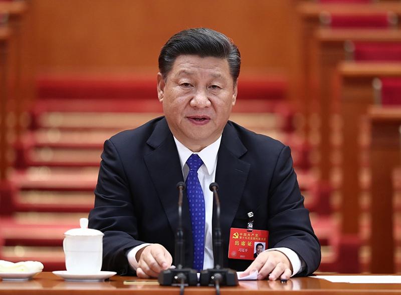 10月17日,中国共产党第十九次全国代表大会在北京人民大会堂举行预备会议。习近平同志主持会议。新华社记者 鞠鹏 摄