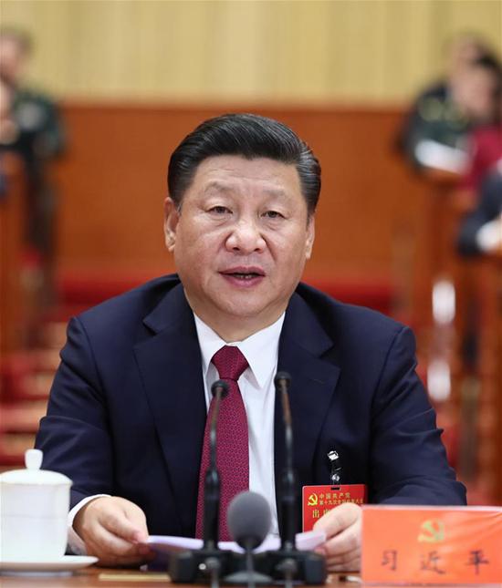 10月24日,中国共产党第十九次全国代表大会在北京人民大会堂胜利闭幕。习近平同志主持大会。 新华社记者 兰红光 摄