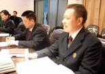 唐如业和同事们开会讨论案情