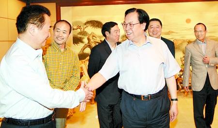 徐光春会见中国企业家俱乐部部分理事