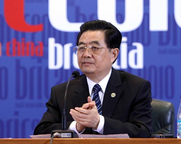 出席会晤的四国领导人共同会见记者,中国国家主席胡锦涛在记者会图片